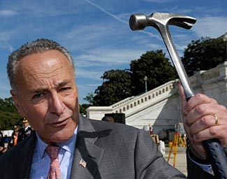 Gun-hating Senator Schumer with a hammer.  Where is his outrage over hammer murders?  What hammer controls does he propose?